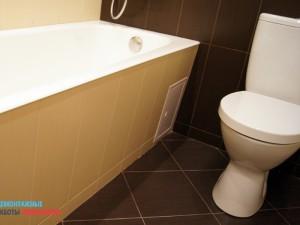 Облицовка экрана ванны плиткой и установка люка